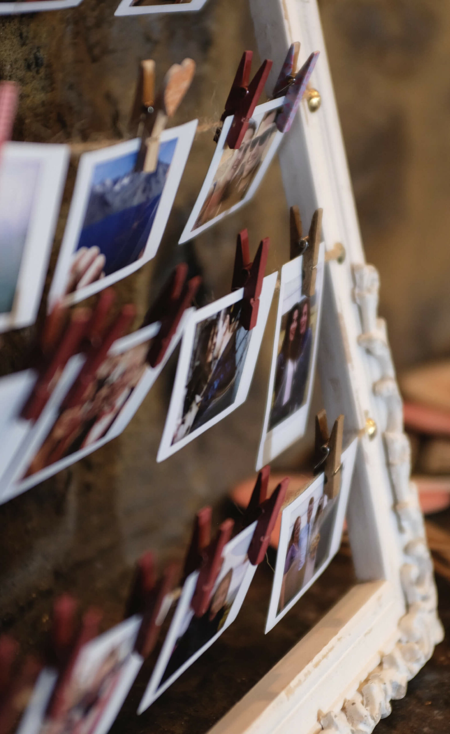 image of several photographs hanging up with clips
