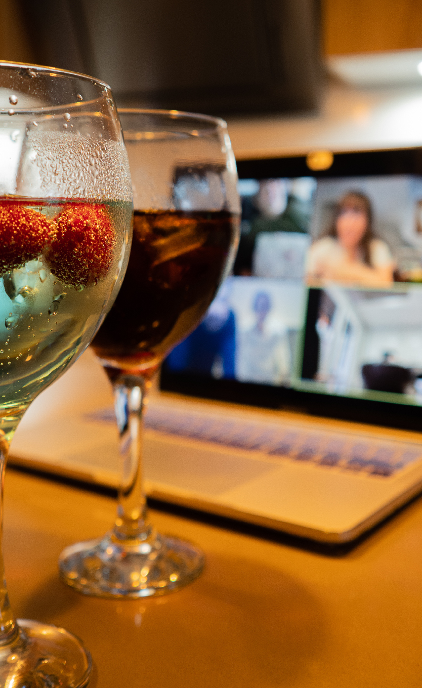 image of wine glasses in front of a laptop