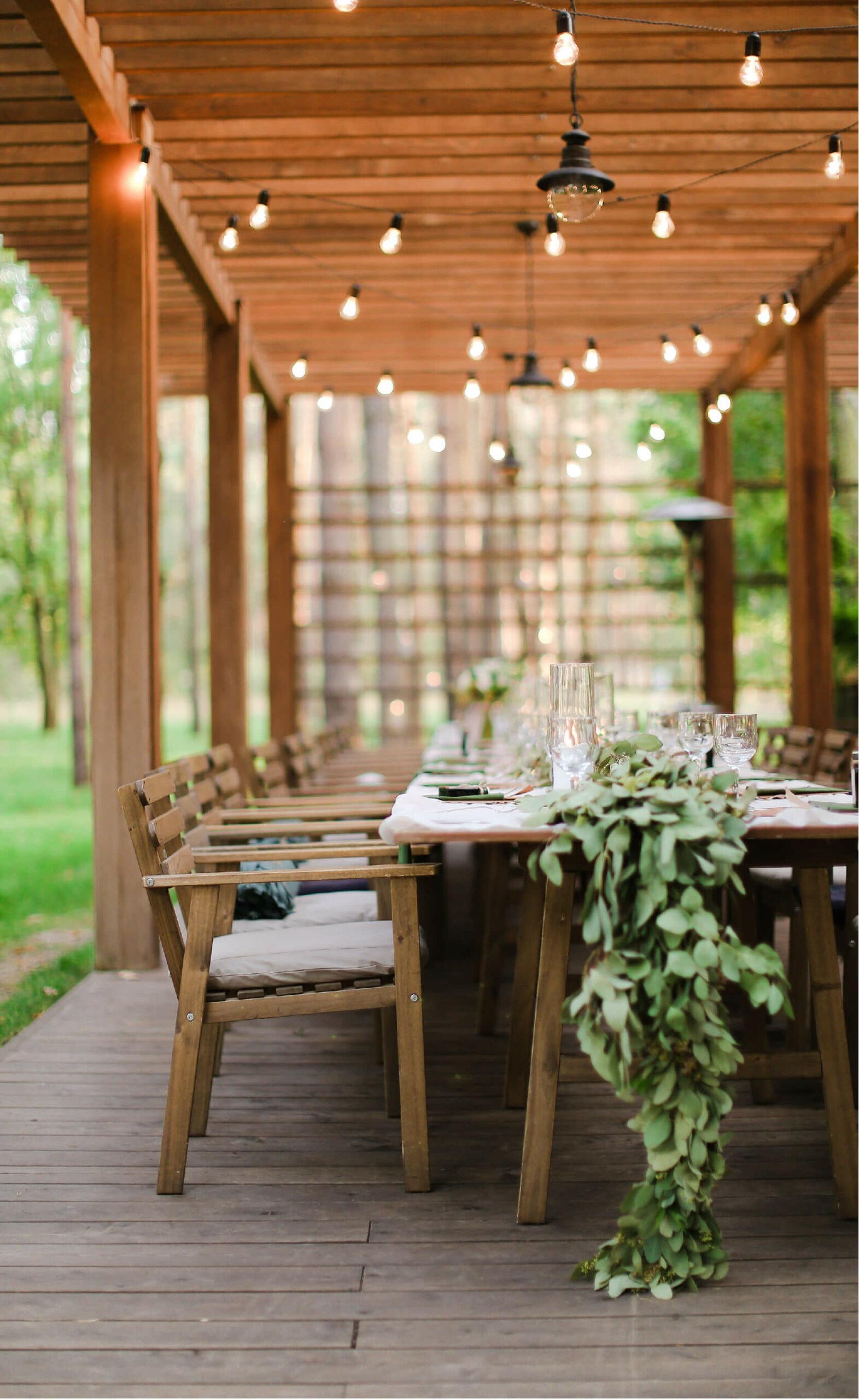 image of an outdoor wedding table with lights above